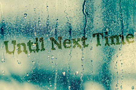 natural water drops on glass window with word