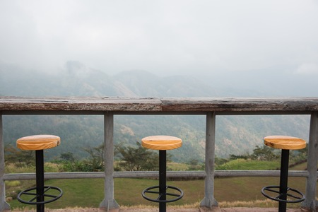 barstool: Outdoor bar counter and bar stools with beautiful natural mountain view background