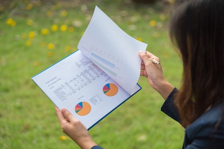 data sheet: woman working with business graph data sheet