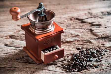 robust: Coffee grinder on wooden table