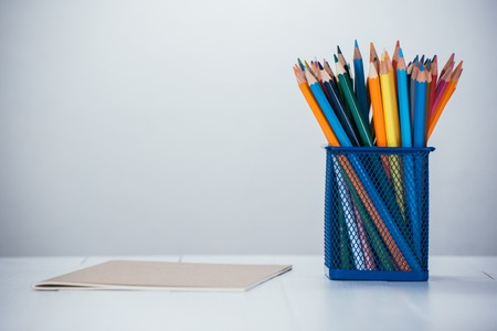 pencil box: color pencil box on wooden table Stock Photo