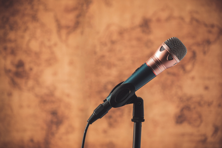 old world: black microphone with blurred old world map background Stock Photo