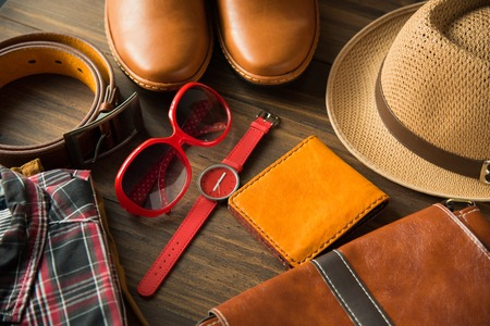 Flat lay of men casual fashion on wooden floor