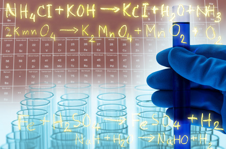 reagents: laboratory test tubes with gold chemical equation background