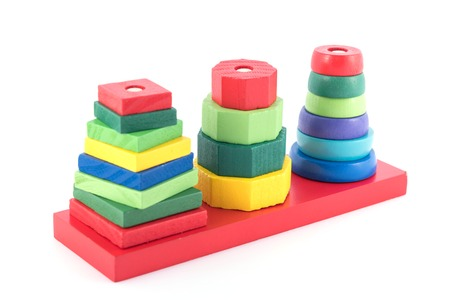 wooden toy: stack of many shape cube building blocks on white background , children toy
