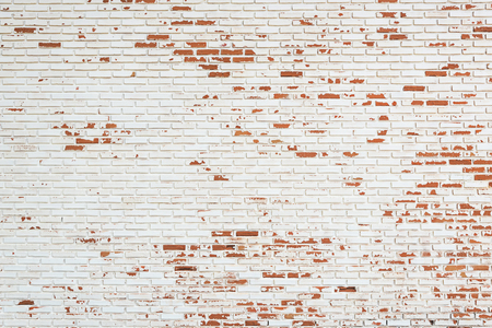 cracked concrete: white and red brick wall as background Stock Photo