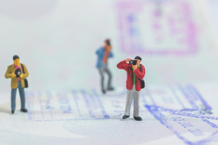 miniature photographer on passport book