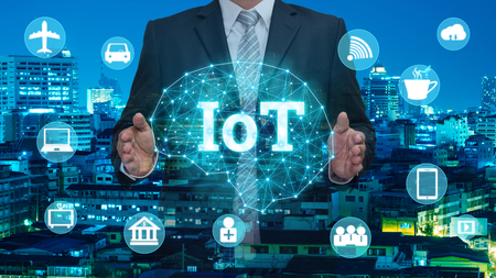 businessmen holding internet of things(IOTs) technology concept over the world