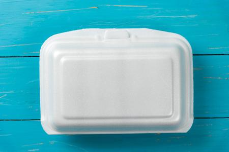 foam box: white foods box on blue table Stock Photo