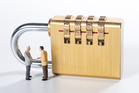 business miniature people try to unlock security lock key Stock Photo