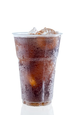 cola with ice in plastic glass on white background