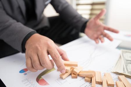 businessman fails building up wood block tower Stock fotó
