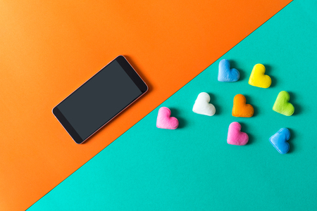 mini heart splash out from smart phone , valentine concept