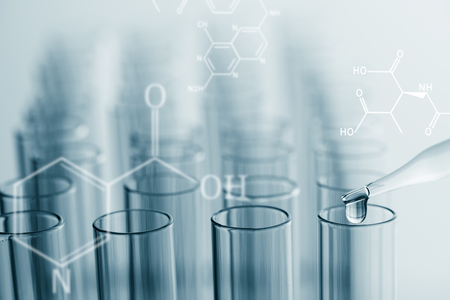 science laboratory test tubes with chemical  formula on screen , lab equipment for research new medical