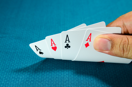 Hand and four aces , playing cards