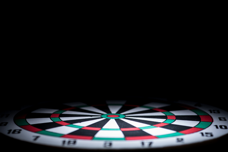 abstract dartboard on dark background lighted with snoot 版權商用圖片