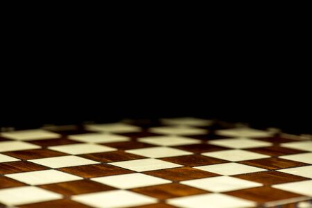 abstract chessboard on dark background Imagens