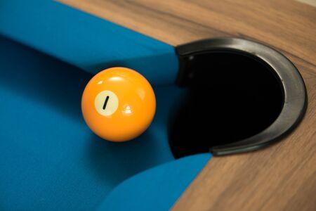 pool or billiards balls on light blue table , focus on number 1 Archivio Fotografico