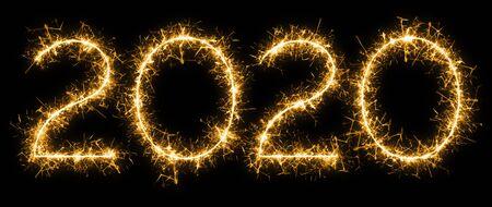 Sparkle firework written year 2020 on black background