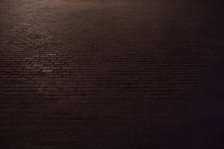 black brick walking street in the dark light Stock fotó