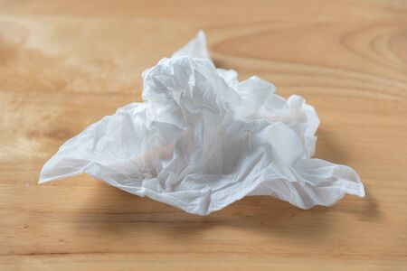 used white tissue paper on wood table background