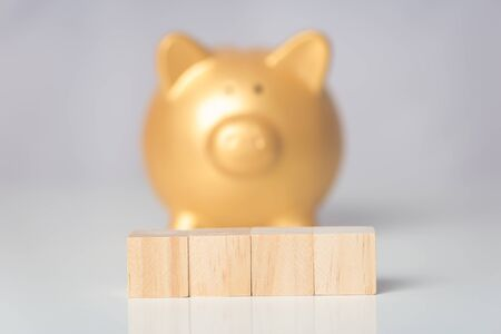 rows of wood cube and piggy bank background