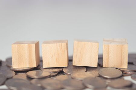rows of wood cube on coins floor