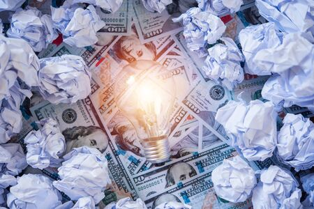 light bulb in the middle of crumpled office paper