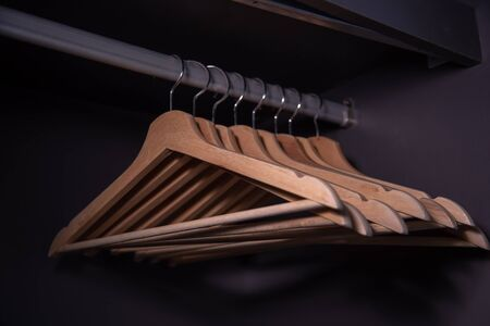 rows of wood anger in the closet