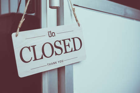 closed signboard hanging at the door