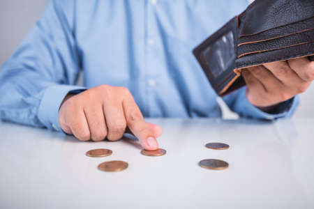 shocked man holding empty wallet