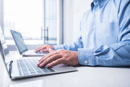 man works using two laptop in the same time