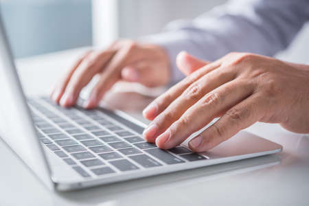 businessman hand using laptop computer