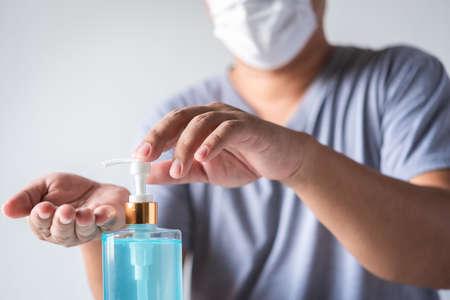 man washing hand with alcohol gel sanitizer to avoid contaminating with Coronavirus