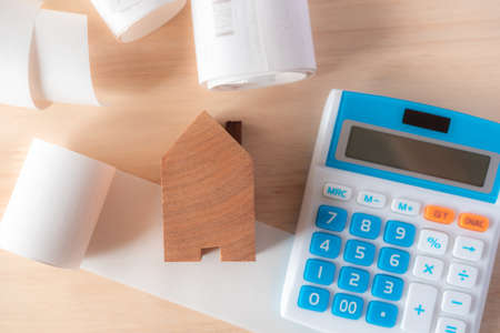 calculator with many bills that must be paid in the house