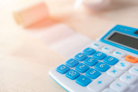 calculator with many bills that must be paid