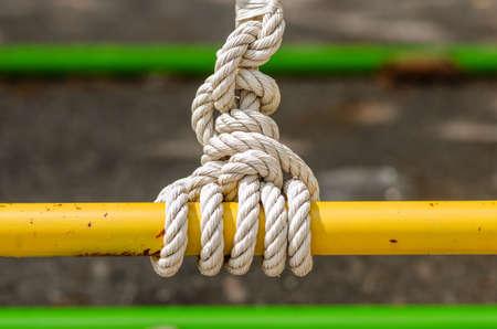 detasil of knot tied on a steel rail