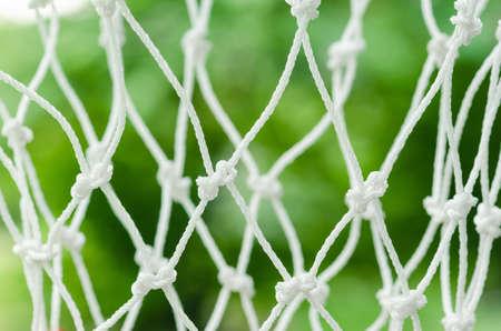 detasil of knot tied on basketball hoop