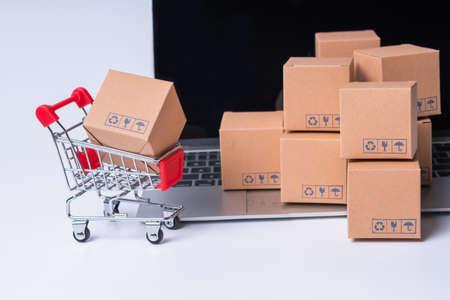 miniature parcel box on laptop, online shopping concept