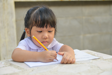 Asian cute student do her homework photo