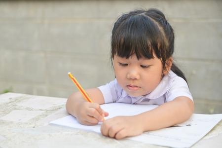 intend: Asian cute student do her homework Stock Photo