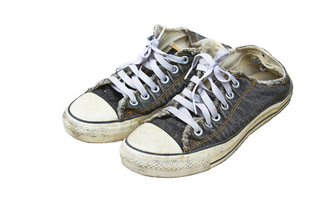 Old black sneakers isolated  photo