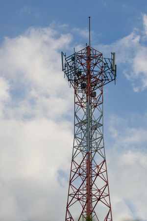 Cell phone signal station on cloud sky photo
