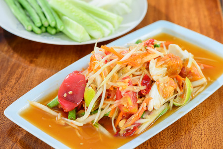Spicy papaya salad with salted eggs  photo