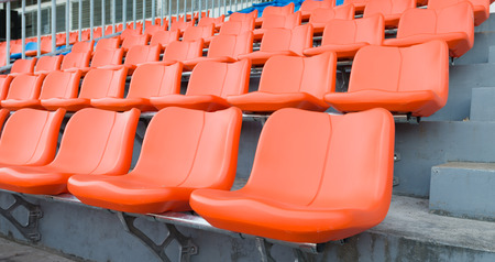 orange chairs: orange grandstand chairs Stock Photo