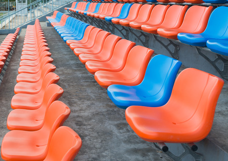 orange chairs: orange and blue grandstand chairs