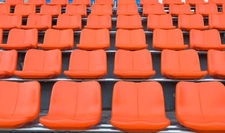 grandstand: orange grandstand chairs Stock Photo