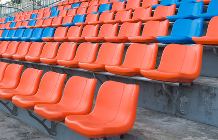 grandstand: orange and blue grandstand chairs