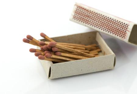 pyromaniac: old matches on white background Stock Photo