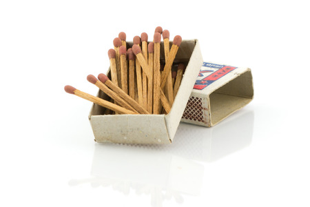 old matches on white background Stock Photo
